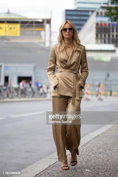 Karolina Kurkova is seen on the street during Berlin Fashion Week wearing copper silk outfit on July 05, 2019 in Berlin, Germany.
