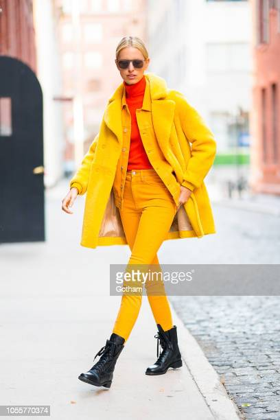 Karolina Kurkova is seen wearing a Bally's coat Calvin Klein top and pants and Chanel boots in Tribeca on October 31 2018 in New York City