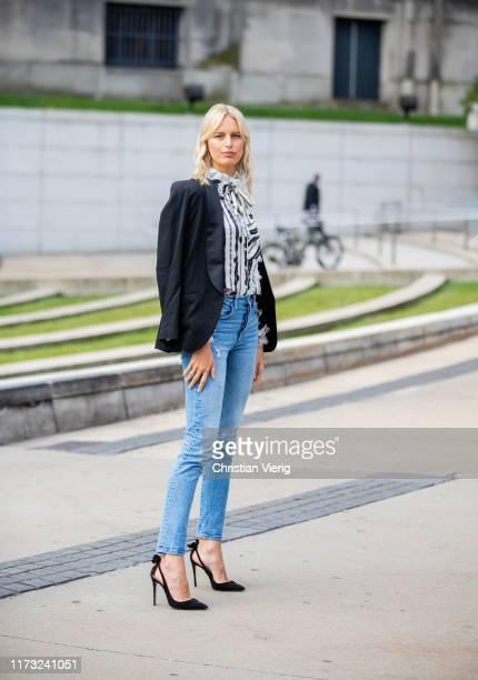 Karolina Kurkova is seen wearing striped blouse Tory Burch, Levis denim jeans outside Tory Burch during New York Fashion Week September 2019 on...