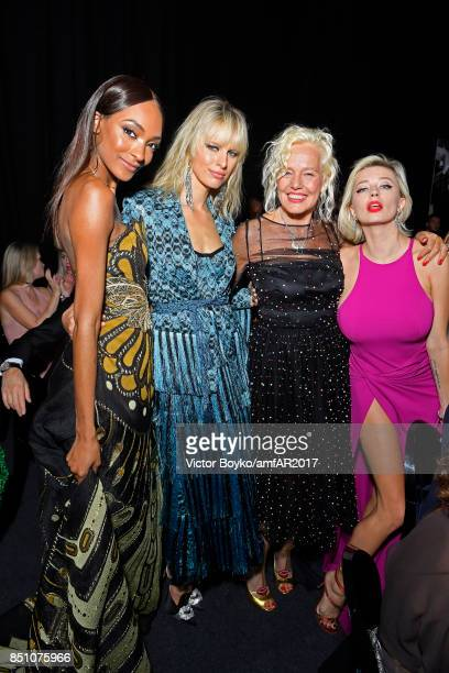 Karolina Kurkova Jourdan Dunn Ellen von Unwerth and Caroline Vreeland attend amfAR Gala Milano on September 21 2017 in Milan Italy