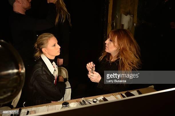 Karolina Kurkova prepares backstage at the Donna Karan New York 30th Anniversary fashion show during MercedesBenz Fashion Week Fall 2014 on February...