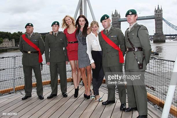 OUT** Karolina Kurkova Rachel Nichols and Sienna Miller pose with Royal Marines at a Photocall to launch 'GI Joe The Rise Of Cobra' held at HMS...