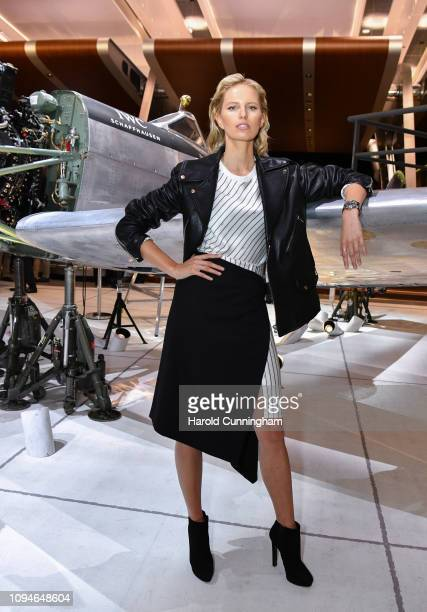 Karolina Kurkova visits the IWC booth during the Maison's launch of its new Pilot's Watches at the Salon International de la Haute Horlogerie on...
