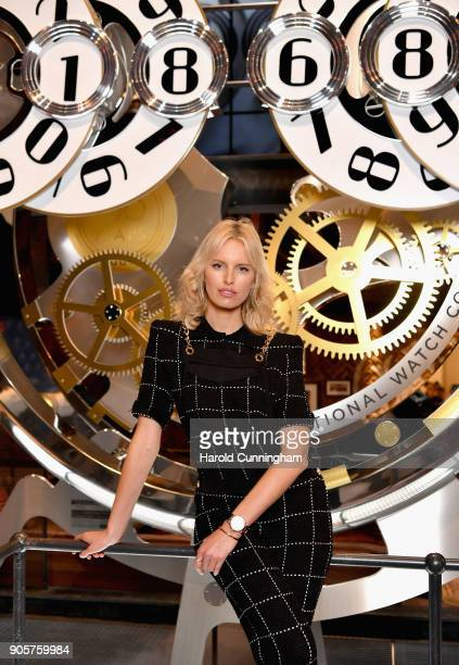 Karolina Kurkova visits the IWC booth during the Maison's launch of its Jubilee Collection at the Salon International de la Haute Horlogerie on...