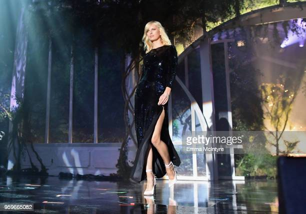 Karolina Kurkova walks the runway at the amfAR Gala Cannes 2018 at Hotel du CapEdenRoc on May 17 2018 in Cap d'Antibes France