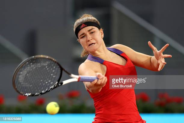 Karolina Muchova of Czech Republic plays a forehand in her ladies singles match against Maria Sakkari of Greece during day six of the Mutua Madrid...