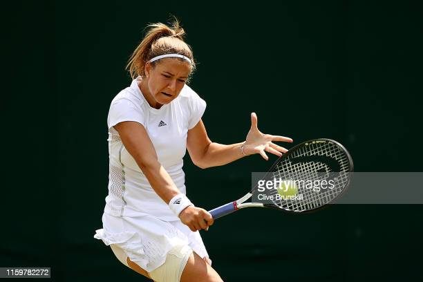 Karolina Muchova of The Czech Republic plays a backhand in her Ladies' Singles second round match against Madison Brengle of The United States during...
