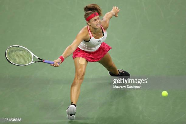 Karolina Muchova of the Czech Republic returns a volley during her Women's Singles fourth round match against Victoria Azarenk of Belarus on Day...