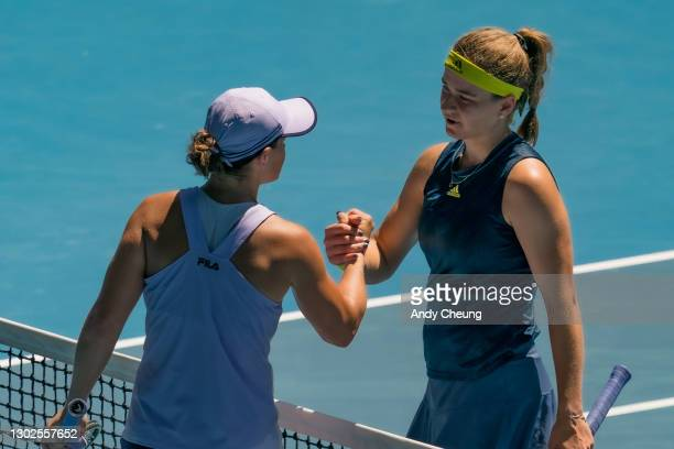 Karolina Muchova of the Czech Republic shakes hands with Ashleigh Barty of Australia in their Women's Singles Quarterfinals match during day 10 of...