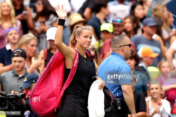 Karolina Muchova of the Czech Republic waives as she leaves the court following her Women's Singles round three match against Serena Williams of the...