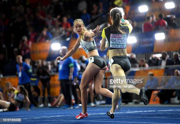 Karolina Pahlitzsch of Germany hands the batton over to Hannah Mergenthaler of Germany during the Women's 4x400m Relay race during day five of the...