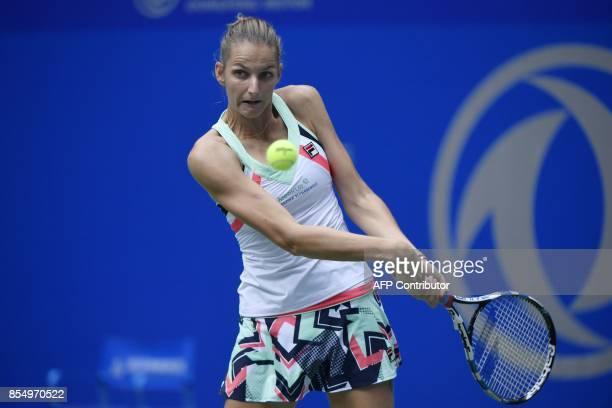Karolina Pliskova of Czech Repubic hits a return against Ashleigh Barty of Australia during their women's singles quarter-final match at the WTA...