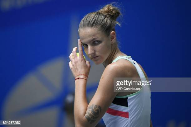 Karolina Pliskova of Czech Repubic reacts before serving against Wang Qiang of China during their third round women's singles match at the WTA Wuhan...