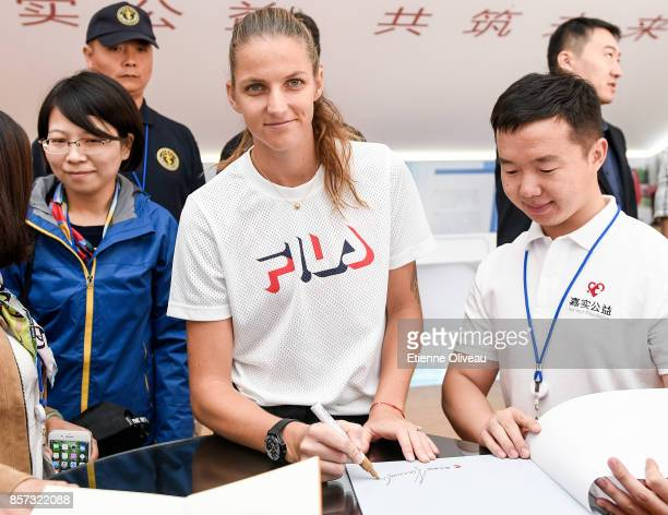 Karolina Pliskova of Czech Repubic signs an autograph at the Harvest fund booth on day five of the 2017 China Open at the China National Tennis...