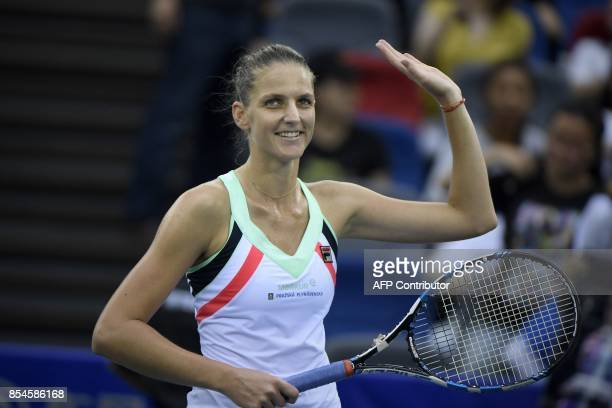Karolina Pliskova of Czech Repubic waves after winning against Wang Qiang of China during their third round women's singles match at the WTA Wuhan...