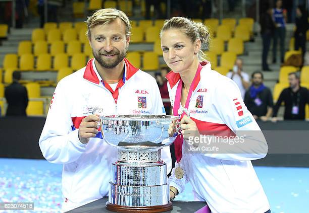 Karolina Pliskova of Czech Republic and her coach Jiri Vanek pose with the trophy following the 2016 Fed Cup Final between France and Czech Republic...