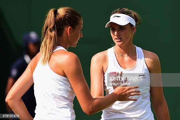 Karolina Pliskova of Czech Republic and Kristyna Pliskova of Czech Republic celebrate a point in their Ladies Doubles First Round match against...