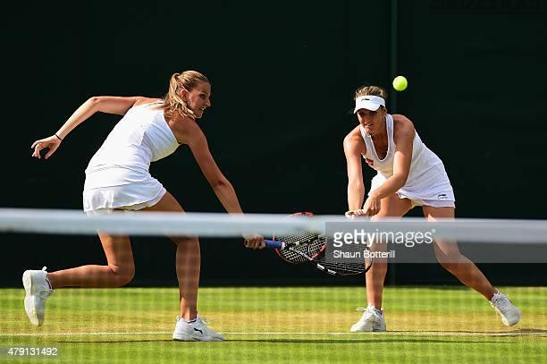 Karolina Pliskova of Czech Republic and Kristyna Pliskova of Czech Republic return a shot in their Ladies Doubles First Round match against Monica...
