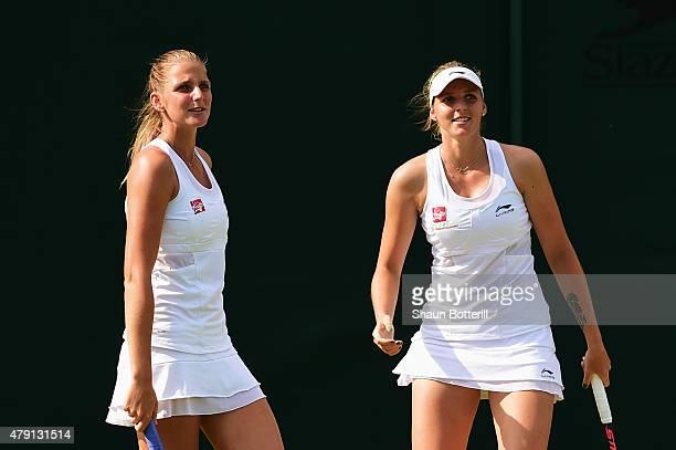 Karolina Pliskova of Czech Republic and Kristyna Pliskova of Czech Republic look on in their Ladies Doubles First Round match against Monica...