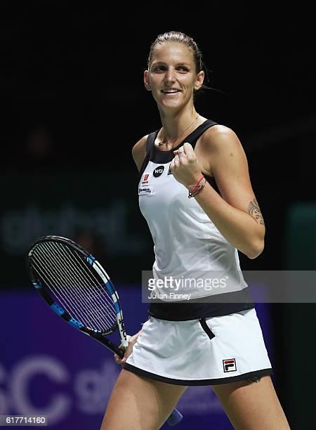 Karolina Pliskova of Czech Republic celebrates victory in her singles match against Garbine Muguruza of Spain during the BNP Paribas WTA Finals...