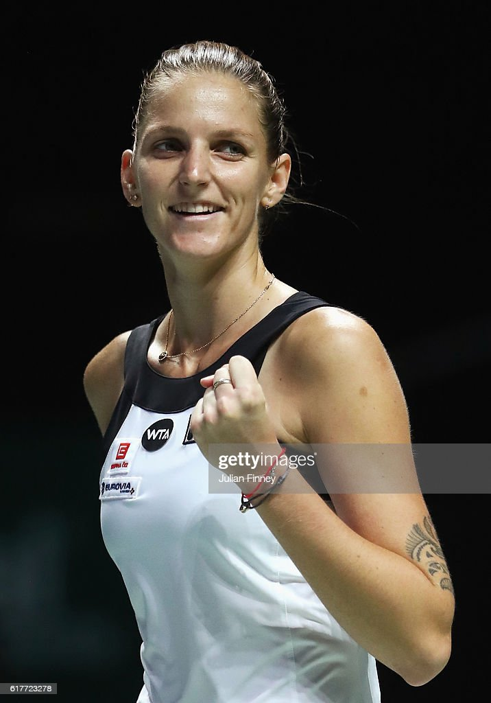 Karolina Pliskova of Czech Republic celebrates victory in her singles match against Garbine Muguruza of Spain during the BNP Paribas WTA Finals Singapore at Singapore Sports Hub on October 24, 2016 in Singapore.