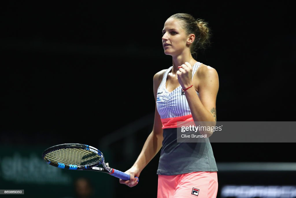 Karolina Pliskova of Czech Republic celebrates victory in her singles match against Garbine Muguruza of Spain during day 3 of the BNP Paribas WTA Finals Singapore presented by SC Global at Singapore Sports Hub on October 24, 2017 in Singapore.