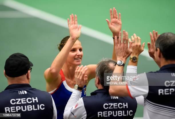 Karolina Pliskova of Czech Republic celebrates with her staff after winning over Mihaela Buzarnescu of Romania their first round tennis match at the...