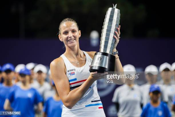Karolina Pliskova of Czech Republic celebrates with the champion trophy after the singles final match against Petra Martic of Croatia on day seven of...