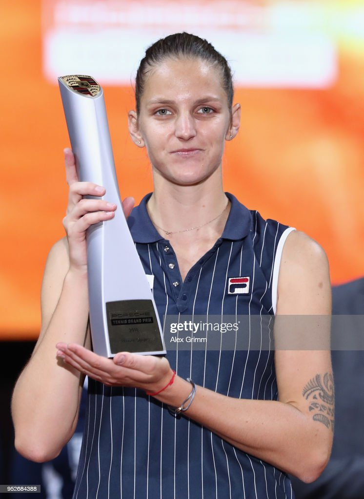 Karolina Pliskova of Czech Republic celebrates with the trophy after winning the singles final match against CoCo Vandeweghe of the United States on day 7 of the Porsche Tennis Grand Prix at Porsche-Arena on April 29, 2018 in Stuttgart, Germany.