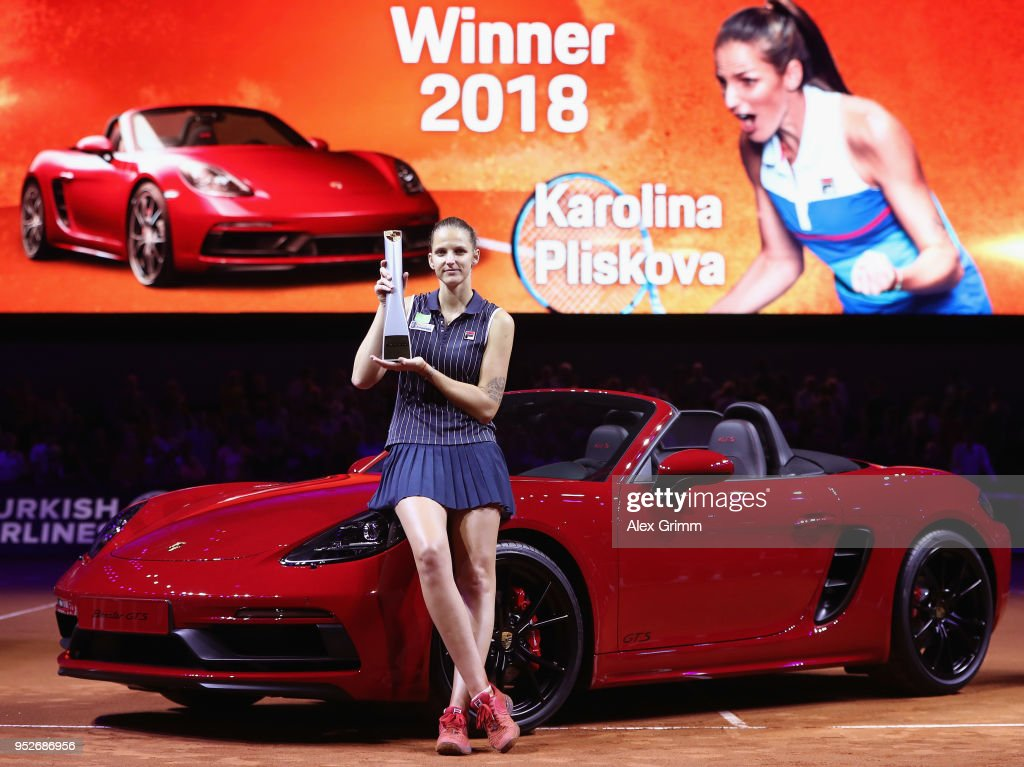Karolina Pliskova of Czech Republic celebrates with the trophy and the winner's car Porsche 718 Boxster GTS after winning the singles final match against CoCo Vandeweghe of the United States on day 7 of the Porsche Tennis Grand Prix at Porsche-Arena on April 29, 2018 in Stuttgart, Germany.