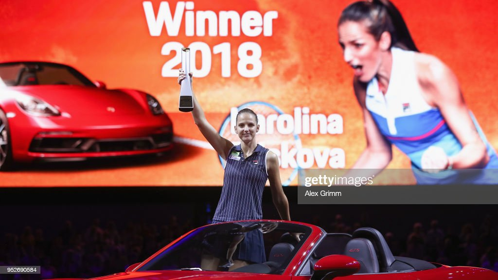 Karolina Pliskova of Czech Republic celebrates with the trophy in the winner's car Porsche 718 Boxster GTS after winning the singles final match against CoCo Vandeweghe of the United States on day 7 of the Porsche Tennis Grand Prix at Porsche-Arena on April 29, 2018 in Stuttgart, Germany.