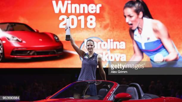 Karolina Pliskova of Czech Republic celebrates with the trophy in the winner's car Porsche 718 Boxster GTS after winning the singles final match...