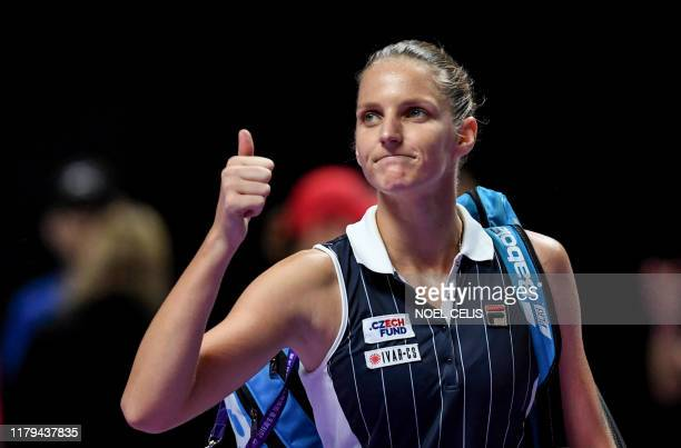 Karolina Pliskova of Czech Republic greets the crowd after losing her women's singles match in the WTA Finals tennis tournament against Ashleigh...