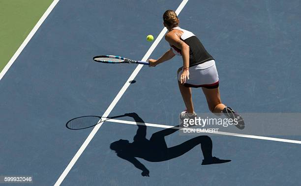 Karolina Pliskova of Czech Republic hits a return against Ana Konjuh of Croatia during their 2016 US Open Womens Singles quarterfinal match at the...