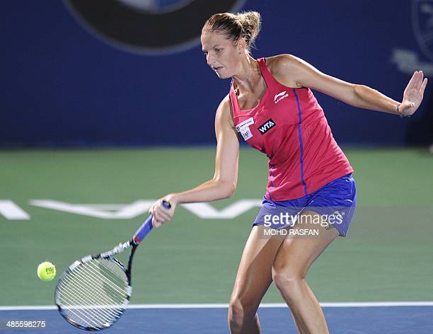 Karolina Pliskova of Czech Republic hits a return against Dominika Cibulkova of Slovakia during their women's semi-final singles match at the BMW...