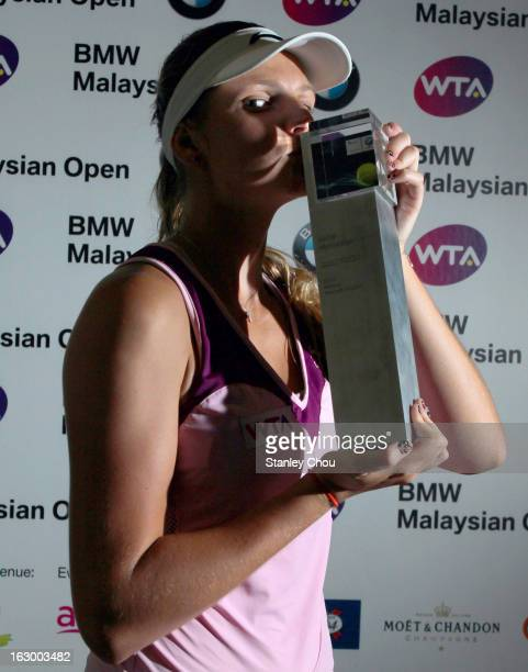 Karolina Pliskova of Czech Republic kisses her trophy after winning the Singles Final match against Bethanie MattekSands of USA during the 2013 BMW...
