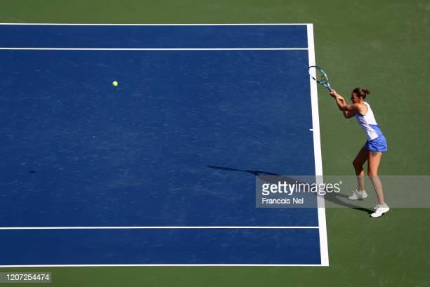 Karolina Pliskova of Czech Republic plays a backhand against Kristina Mladenovic of France during Day Three of the Dubai Duty Free Tennis at Dubai...