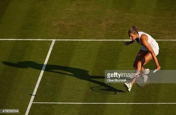 Karolina Pliskova of Czech Republic plays a backhand during her Women's Singles Second Round match againstSvetlana Kuznetsova of Russia during day...
