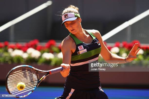 Karolina Pliskova of Czech Republic plays a forehand in her match against Lesia Tsurenko of Ukraine during day one of the Mutua Madrid Open tennis at...