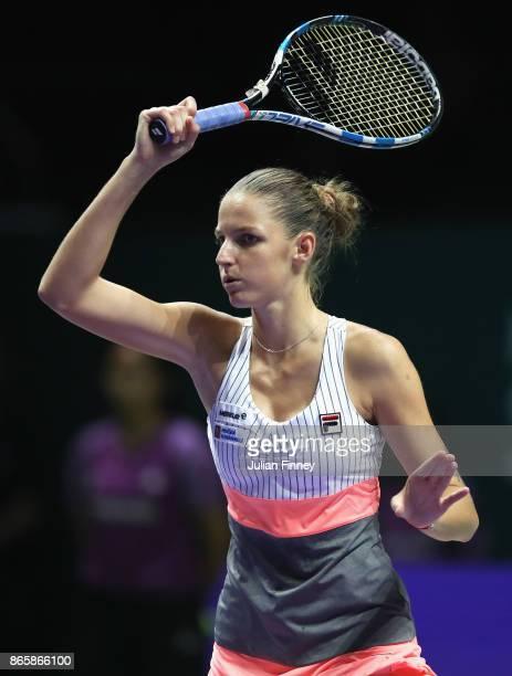Karolina Pliskova of Czech Republic plays a forehand in her singles match against Garbine Muguruza of Spain during day 3 of the BNP Paribas WTA...