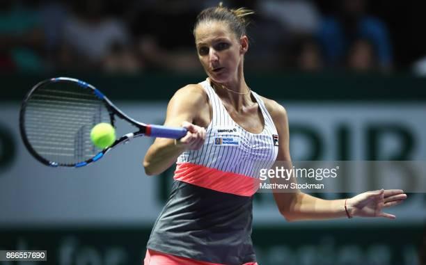Karolina Pliskova of Czech Republic plays a forehand in her singles match against Jelena Ostapenko of Latvia during day 5 of the BNP Paribas WTA...