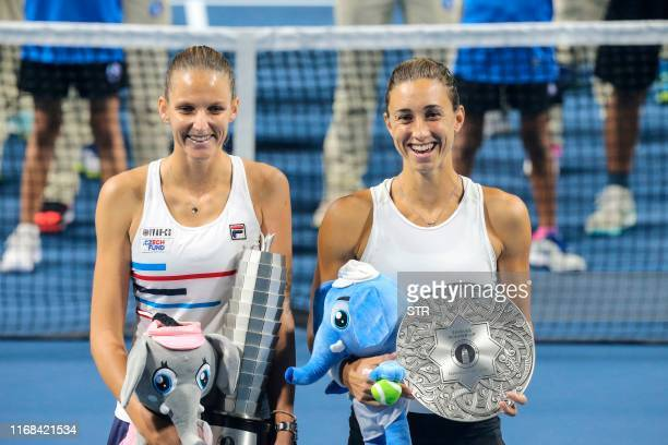 Karolina Pliskova of Czech Republic poses for photographs with second-placed Petra Martic of Croatia after the women's singles final match at the...