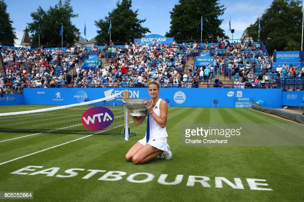 Karolina Pliskova of Czech Republic poses for photos with the cup after in winning her women's singles finals match against Caroline Wozniacki of...