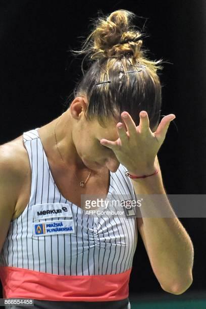 Karolina Pliskova of Czech Republic reacts after a point against Jelena Ostapenko of Latvia during the WTA Finals tennis tournament in Singapore on...