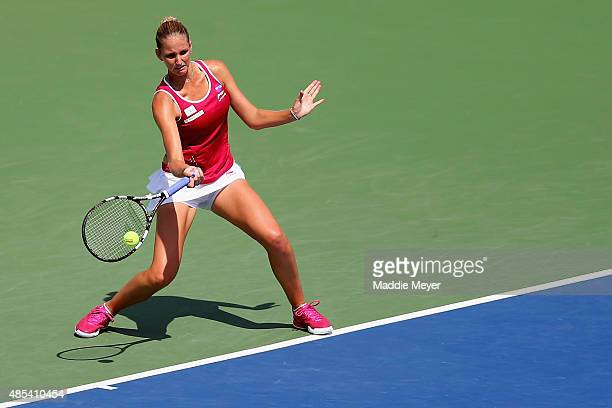 Karolina Pliskova of Czech Republic returns a shot to Lesia Tsurenko on Day 4 of the Connecticut Open at Connecticut Tennis Center at Yale on August...