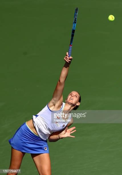 Karolina Pliskova of Czech Republic serves against Kristina Mladenovic of France during Day Three of the Dubai Duty Free Tennis at Dubai Duty Free...