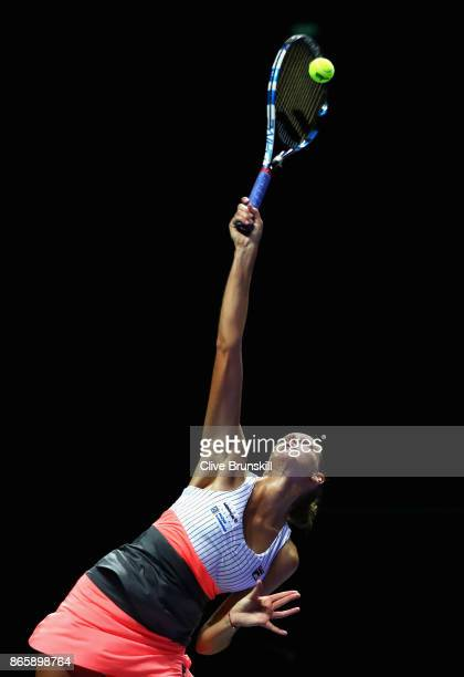 Karolina Pliskova of Czech Republic serves in her singles match against Garbine Muguruza of Spain during day 3 of the BNP Paribas WTA Finals...