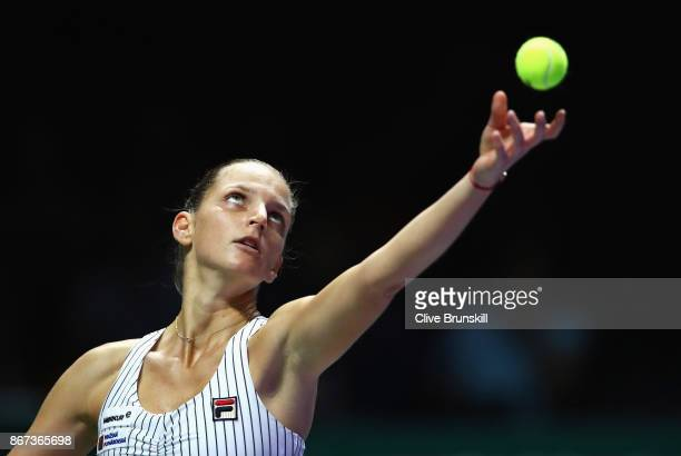 Karolina Pliskova of Czech Republic serves in the singles semi final match against Caroline Wozniacki of Denmark during day 7 of the BNP Paribas WTA...
