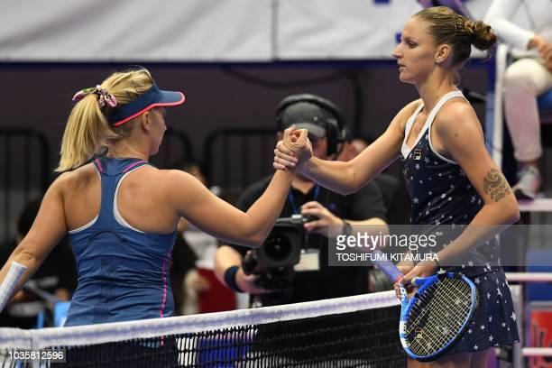 Karolina Pliskova of Czech Republic shakes hands with Daria Gavrilova of Australia after winning their women's singles second round match at the Pan...