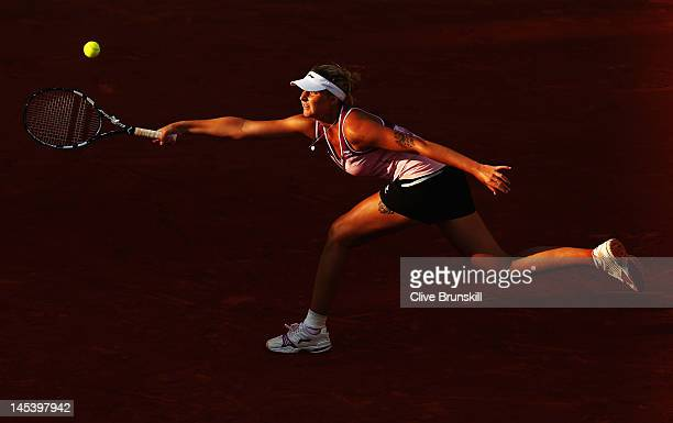 Karolina Pliskova of Czech Republic stretches to play a forehand in the women's singles first round match between Karolina Pliskova of Czech Republic...